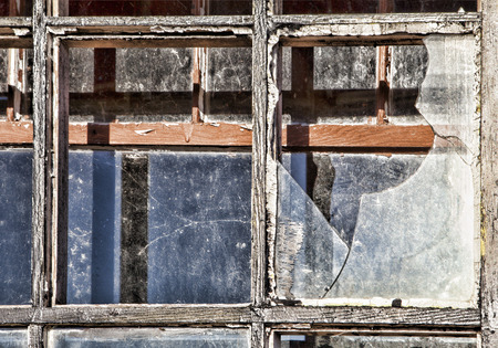 urban decay: Old broken windows from an abandoned building in daylight.
