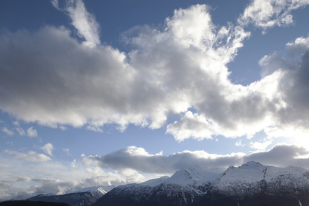 southeast alaska: Clouds over the Chilkat range in Southeast Alaska in evening with a setting sun.