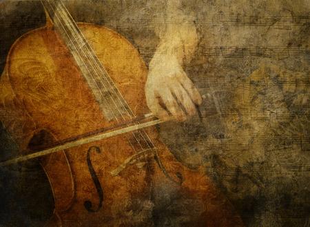 Klassieke cello wordt bedekt met texturen en bladmuziek gespeeld voor een vintage artistieke look. Stockfoto