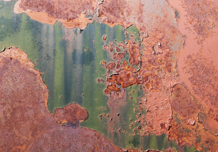 abandoned car: Abstract patterns on a rusty abandoned car surface with colorful patterns. Stock Photo