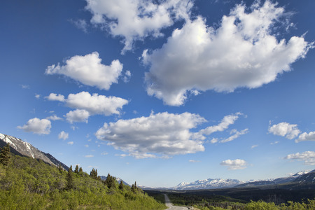 puffy: Views from the Haines Highway in Yukon Territory Canada in summer with puffy clouds.