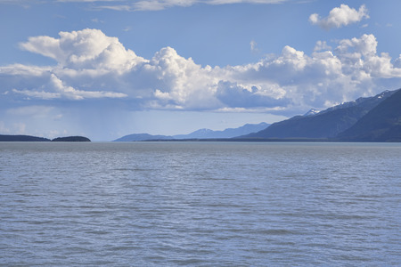 southeast alaska: Puffy clouds forming over the Chilkat Inlet in Southeast Alaska in summer.