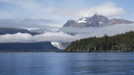 southeast alaska: Gill net commercial fishing boat in Southeast Alaska off Seduction Point in the Lynn Canal with mountains and a glacier in the background.