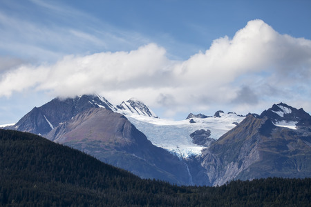 southeast alaska: Rainbow Glacier in Southeast Alaska near Haines in summer with clouds and blue sky.
