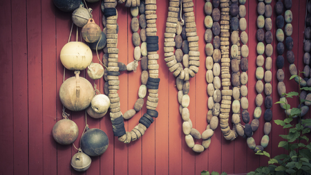 fishing floats: Collection of vintage fishing floats hung on a red wall with vintage coloration.