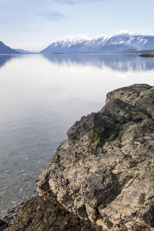 southeast alaska: View from Chilkat State Park in Southeast Alaska to the calm water of the inlet. Stock Photo