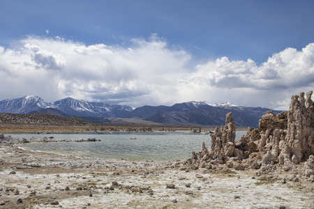 sierras: Mono Lake in California with tufa towers and clouds building over the mountains. Stock Photo