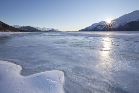 inlet: Sunset from a Chilkat Inlet beach near Jones Point, Haines Alaska in winter.