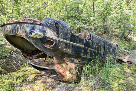 dumped: Old wreck in the woods. Stock Photo