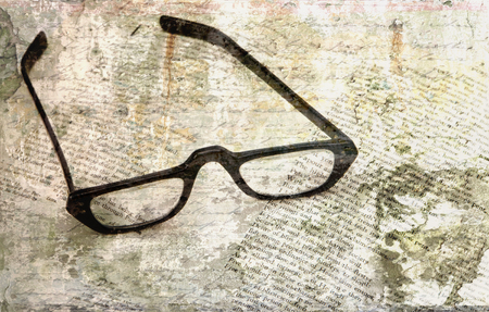 public domain: Black reading glasses on text (public domain by Dante) with overlay layers of texture and handwriting for an artistic look. Stock Photo