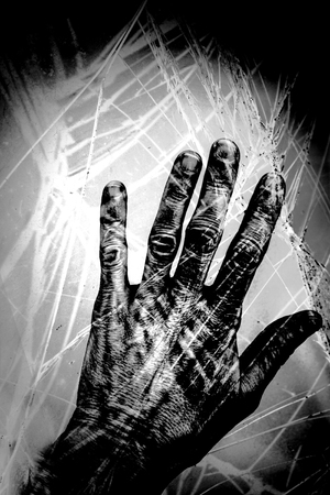 photomanipulation: Old wrinkled hand with broken glass overlay  and textures in black and white.