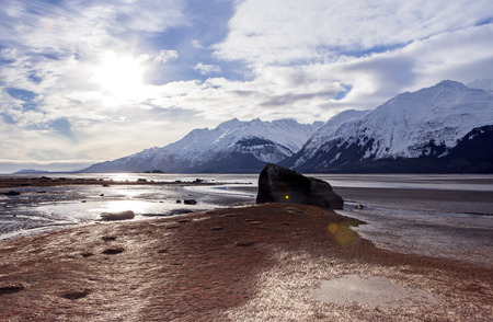 estuary: Clouds with shadows and light on the Chilkat estuary near Haines Alaska at low tide.