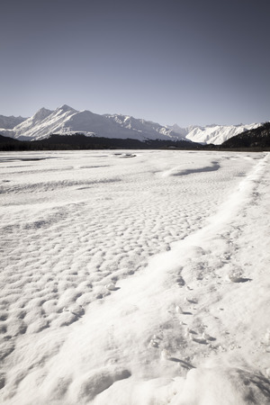 southeast alaska: Frozen Klehini river with snow in Southeast Alaska up the Haines Highway on a sunny winter day. Stock Photo