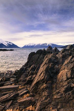 southeast alaska: Rocky shore in Southeast Alaska with storm clouds forming. Stock Photo