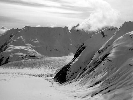 southeast alaska: Glacier in the mountains of Southeast Alaska in early spring in black and white.