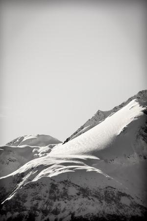 Alaskan mountain peak in the Chilkat range in southeast Alaska with snow. Imagens