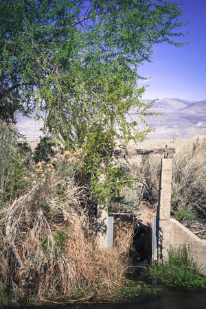 diversion: Old water diversion structure near an old ranch on a creek near Bishop California in summer.