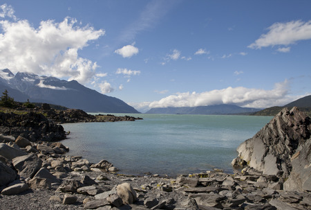 View of the Chilkat Inlet in Southeast Alaska near Haines from a secluded beach on a sunny summer day.