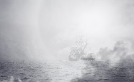 Alaska commercial fishing trawler boat with an overlay of fog.
