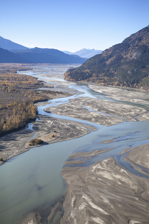 Chilkat river in Alaska as seen by air with braided patterns and fall colors.
