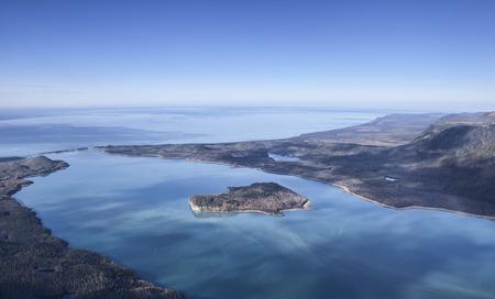Aerial photo of Lituya Bay off the coast of Southeast Alaska on a sunny day with blue sky.
