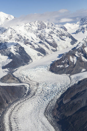 Glacier in Southeast Alaska curving through a valley shot from a small plane.