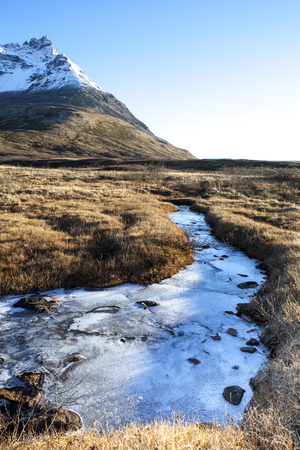 frozen creek: Frozen creek in the mountains of British Columbia Canada in fall before the snows. Stock Photo