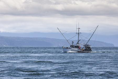stabilizers: Salmon trolling boat in Lynn Canal in Southeast Alaska in summer.