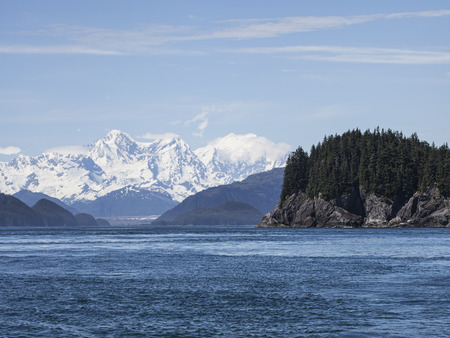 View from the water in Cross Sound passing the Inian Islands with a view of the Brady Glacier in Southeast Alaska
