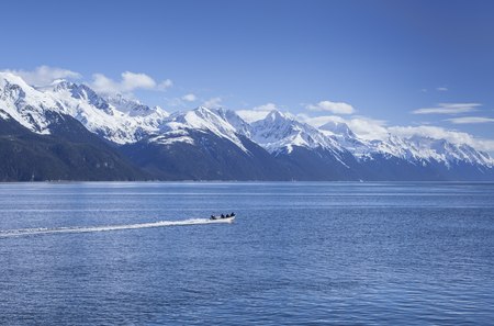 Aluminum skiff in the Lynn Canal in Southeast Alaska on a beautiful day.