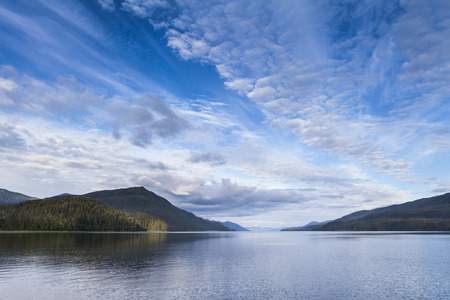 Clouds over the inside passage in Southeast Alaska in summer. Stock Photo