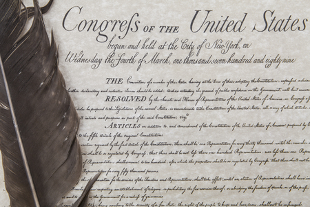 Close crop of the United State's Bill of Rights with an eagle feather pen.