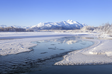 Chilkat river in Southeast Alaska on a sunny winter day after snow. Stock Photo