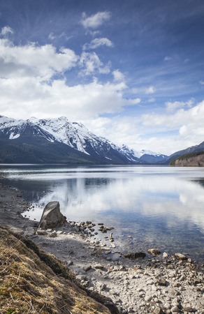 Spring at the Chilkat Lake near Haines in Southeast Alaska with clouds and reflections. Stock Photo