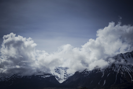 Clouds over mountain peaks in Southeast Alaska.