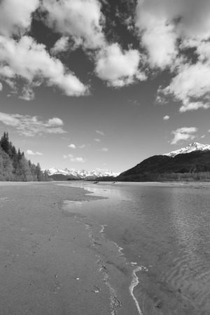 Chilkat River Beach near Haines Alaska in black and white. Stock Photo