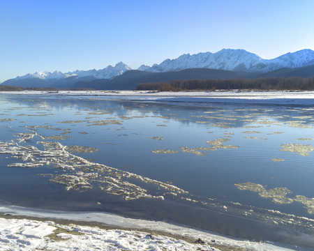 Floating ice in the Chilkat River in Southeast Alaska near Haines after the first snow in early winter.