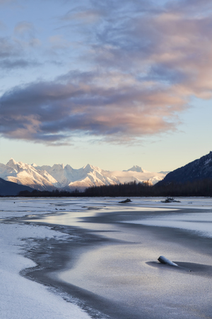 Chilkat river with the Coast Range mountains in Southeast Alaska near Haines  with a winter sunset.