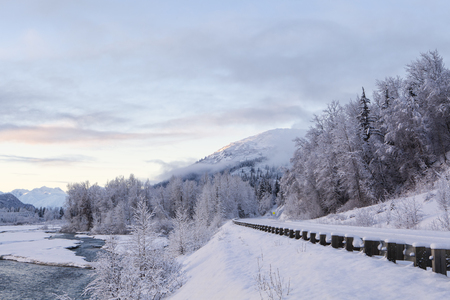 Winter sunset along the Haines Highway with the Klehini river and snow. Stock Photo