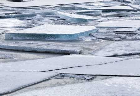 Large ice chunks on a frozen river in  Alaska.