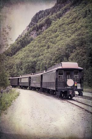 Vintage train near Skagway Alaska with textures added for a retro look. Stock Photo