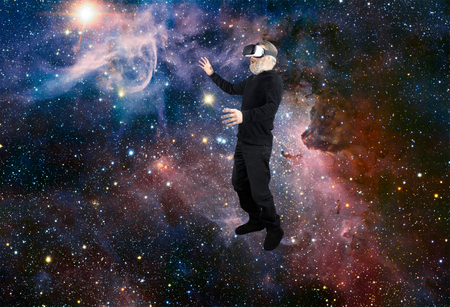 Man with VR Virtual Reality experiencing the wonders of space looking at a star. Stock Photo