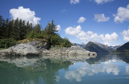 View of an arm off Dundas Bay in Southeast Alaska as seen from a kayak in summer. Stock Photo