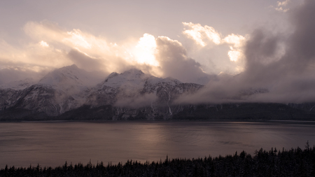 Aerial photo of the Chilkat Inlet near Haines Alaska at sunset with clouds and fog.