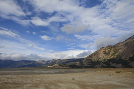 Drying sand flats near Kluane Lake in Yukon Canada in summer with dramatic clouds. Stock Photo