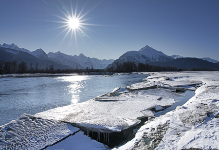 Ice melting on the Chilkat River in Southeast Alaska on a sunny day in spring.