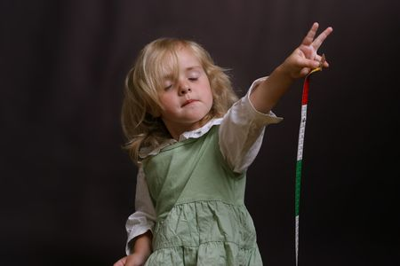 little girl showing victory Stock Photo - 519467