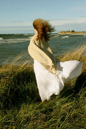 windy energy: girl on  windy day near the see Stock Photo