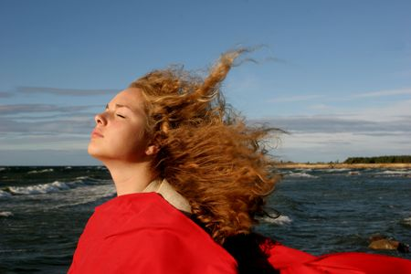 girl on suny  windy day near the sea