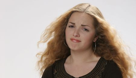 disappointed pretty girl with curly hair